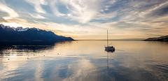 FUJI7528-2 (capturedbyflo) Tags: sunset sea lake mountains alps reflection water landscape switzerland boat fuji suisse fujifilm leman paysage reflets montreux waterscape xt1