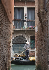 Gondolier from alleyway (Ranyan23) Tags: venice water boat canal alley walls godola gondolierstripes