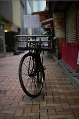 bike portrait (gavingmb) Tags: china street travel portrait urban hk travelling bike bicycle hongkong 50mm prime alley nikon day dof bokeh outdoor working utility alleyway paving commuting f18 fx workbike travelphotography utilitarian d610