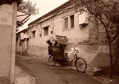 "China Beijing hutong backalley with tour rickshaw - ""At Rest"" (moreska) Tags: china city urban blackandwhite streets monochrome bicycle sepia architecture slick asia quiet afternoon tour backalley outdoor empty gray beijing kingdom oldschool trike hutong middle rickshaw narrow damp drizzle hepingman"