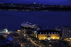 Old Quebec Waterfront Skyline (Sky Solar) Tags: city travel urban castle history tourism ferry skyline architecture night buildings river lights boat cityscape waterfront quebec arts stlaurent nightfall