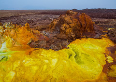 The colorful volcanic landscape of dallol in the danakil depression, Afar region, Dallol, Ethiopia (Eric Lafforgue) Tags: africa travel lake color tourism nature pool beauty horizontal landscape outdoors volcano spring colorful solitude day desert natural earth acid horizon surreal nobody nopeople formation serenity heat minerals environment sulphur isolation geography geology ethiopia hotspring volcanic saline geothermal interest arid ecosystem hornofafrica afar eastafrica geological abyssinia afarregion dallol danakildepression ethio161989