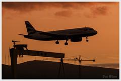 Belfast City Airport Arrival (D.k.o.w) Tags: sunset sky silhouette airplane belfast landing orangesky northernireland britishairways runway flybe georgebest belfastcityairport canon7dmkii