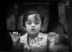 The lost soul (Syed Hamza Hassan) Tags: blackandwhite bw baby cute window beauty female portraits hair lost toddler child candid adorable nails busy thoughts vehicle frock moment past sorrow multan engrossed pains
