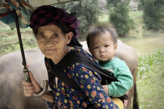 Grandmother of the Hmong ethnic minority in H Giang province carrying her grand-son - Vietnam (PascalBo) Tags: boy people woman outdoors costume kid nikon asia southeastasia vietnamese child outdoor femme vietnam asie ethnic minority enfant hmong indigenous garon ethnicity headdress hilltribe headwear d300 vitnam vitnam hagiang ethnie ethnicgroup asiedusudest hgiang pascalboegli