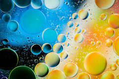 Planets (lkaldeway) Tags: blue stilllife orange abstract color colour macro texture water colors closeup colours circles background indoor bubble oil