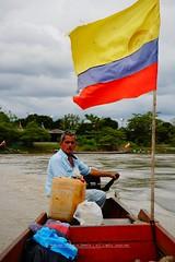 Crossing the Ariari River (FabioZabala) Tags: a6000 ilce sony mirrorless ariari river rio colombia meta people