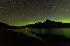 Aurora Trails - Lake Minnewanka (Explored!) (acreativename) Tags: alberta banff aurora water lakeminnewanka startrails reflections mountains night nightsky stars nikon d610 tamron1530