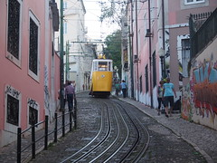 A tram inbetween narrow sidestreets