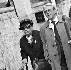 Move along, nothing to see here. (Baz 120) Tags: life street city portrait people urban blackandwhite bw italy rome roma monochrome mono italia faces candid strangers streetphotography streetportrait olympus monotone streetphoto unposed 45mm omd decisivemoment candidportrait streetphotographer m43 streetcandid mft streetphotograph primelens em5 candidstreet candidface