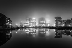 Hidden Towers (Scott Baldock) Tags: longexposure nightphotography mist reflection london water fog night skyscraper marina canon buildings reflections dark scott lights cityscape low atmosphere basin docklands canarywharf offices 6d 1740l baldock flickrfriday cityarchitecture mistandfog