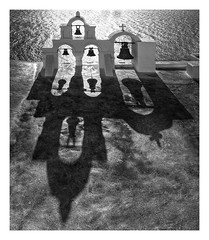 The bells of Oia (kurtwolf303) Tags: ocean shadow sea bw topf25 bells blackwhite topf50 topf75 meer 500v20f cross hellas olympus belltower kreuz santorini greece sw topf150 griechenland topf100 schatten oia cyclades thira omd glocken glockenturm schwarzweis 3000views 99f 4000views 1250mm em5 1500v60f 1000v40f kykladen 3000v120f 250v10f innamoramento monochromefineart lovelycity unlimitedphotos micro43 microfourthirds minimum2000views skancheli digitalartscenepro minimum1000v minimum1500v 100favesonly
