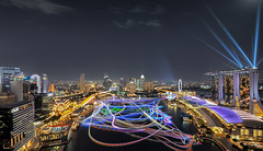 Warped World (Mabmy) Tags: boats lumix town flyer singapore olympus laser cbd lighttrails lasershow mbs em1 7mm oue livecomposite