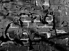 Wall Peeling (Greyframe) Tags: old blackandwhite black color brick texture wall fetish trash paint pattern hole skin ripped bad dream surface off rubber structure crack suit freak torture scream batman latex peek 100 rough coming peel gummi peeled shout baddream pech teer greyframe