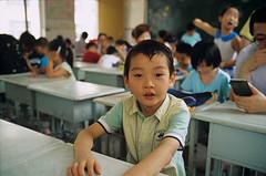 Boy () Tags: china street leica boy portrait people film analog kid wuxi child kodak bokeh snapshot chinese documentary rangefinder 35mmfilm positive summilux leicam7 streetshot m7 kodakfilm filmphotography cinefilm 5285 flickeraward 100d leicasummilux35mmf14asph m3514a 100d5285 summiluxm3514a