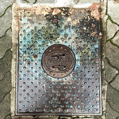 Portrait Of A Manhole (ravenbelle) Tags: street blue urban texture geometric metal vancouver manhole granvilleisland rectangle