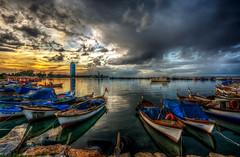 Colours of sunset (Nejdet Duzen) Tags: trip travel sunset sea reflection turkey boat cloudy trkiye deniz sandal izmir gnbatm yansma turkei seyahat bulutlu inciralt