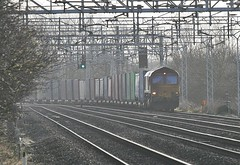 66011 Passing Chorlton Lane (uksean13) Tags: train canon cheshire diesel transport rail railway loco locomotive freight class66 ews ef70200mmf4lusm 400d 66011