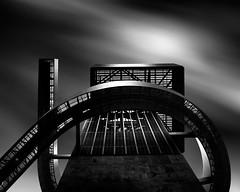 Under The 9 (Tony DeSantis Photography) Tags: longexposure school sky blackandwhite building architecture square la losangeles movement downtown 9 socal le round tonydesantisphotography