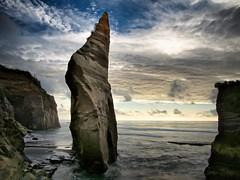 Skywards (loveexploring) Tags: longexposure sea newzealand cloud seascape beach northisland lowtide taranaki seastack thethreesisters ndfilter youngestsister tongaporutu newsister