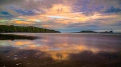 Reflections of Rhossili (absynth100) Tags: uk light sunset sea sky seascape water wales clouds reflections sand dramatic calm cliffs gower headland
