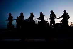 USS Barry conducts a replenishment-at-sea. (Official U.S. Navy Imagery) Tags: ocean people team ship navy line sillouette sailor naval teamwork philippinesea