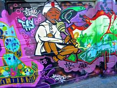 Snake Charmer, San Francisco, CA (Robby Virus) Tags: sanfrancisco california tms snake charmer art street garage door mission district mural