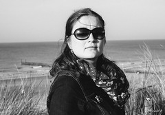 sunglass woman (G.Don) Tags: ocean sea portrait woman sun reflection beach sunglasses zeiss pier cool fuji dunes contax sunrays f28 45mm tessar 4528 xe2