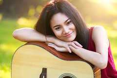 Closeup young asian woman sitting with guitar in park (Patrick Foto ;)) Tags: park summer portrait people music woman playing green nature girl beautiful beauty smile grass closeup female asian fun thailand outside outdoors happy person one spring holding pretty day sitting child singing adult natural guitar outdoor background joy young happiness teen thai instrument teenager acoustic concept cheerful joyful guitarist teenage