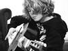 Kai on guitar (real ramona) Tags: portrait guitar olympus acoustic grainy e1 fretboard zuiko50mmf2