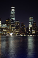 World Trade Center with reflections (Lojones13) Tags: newyork reflection water night canon river manhattan worldtradecenter eoskissx3