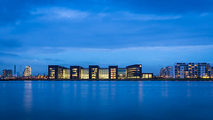 Lighting up the skyline (McQuaide Photography) Tags: city longexposure blue cold holland reflection building water netherlands amsterdam architecture canon landscape eos lights evening licht twilight lowlight europe dusk tripod nederland shell le bluehour fullframe dslr avond 1740mm modernarchitecture hdr stad ij gebouw lightroom waterscape 6d lseries photomatix stca canon6d shelltechnologycentreamsterdam mcquaidephotography