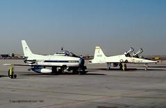 N80FS & 67-14938 - CL-13 Sabre & T-38A Talon share the Luke ramp in 1987 (egcc) Tags: luke sabre talon usaf usairforce afb canadair f86 lukeafb northrop luf t38a cl13 kluf flightsystems n80fs 6714938 t6079