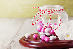 Candy with colored glaze (jevgeni40) Tags: birthday pink red food white holiday texture glass childhood dessert wooden colorful candy bright sweet background board decoration tasty sugar gourmet celebration delicious glaze tiny snack round pastry jar icing treat taste variety various shape assortment confectionery unhealthy glazed confection sweetmeat