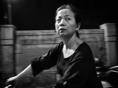 nightcycling (dr.milker) Tags: street urban blackandwhite bw woman blancoynegro monochrome bicycle blackwhite alley noiretblanc taiwan taipei