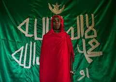Sufi woman worshipper in front of islamic green flag, Harari region, Harar, Ethiopia (Eric Lafforgue) Tags: africa red portrait people woman color green horizontal scarf outdoors photography women day adult african flag muslim islam faith religion unescoworldheritagesite indoors shawl spirituality ethiopia sufi sufism worshipper oneperson developingcountry hornofafrica ethiopian harrar eastafrica placeofworship harar abyssinia arabiccalligraphy traditionalclothing onewomanonly lookingatcamera harari oromo waistup 1people harer onlywomen harariregion oneadultonly hararjugol ethio162909