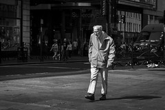 We Walk Alone (Leanne Boulton) Tags: life street old city uk light shadow portrait people urban blackandwhite bw sunlight white man black detail male texture monochrome face canon walking 50mm mono scotland living blackwhite mood shadows natural emotion humanity outdoor expression glasgow candid culture streetphotography atmosphere streetlife scene human elderly age shade 7d isolation aged posture feeling society depth tone facial gait candidstreetphotography