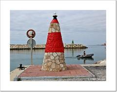 Dos faros (Lourdes S.C.) Tags: costa mar andaluca nubes puertos faros puertomarina benalmdenacosta costamediterrnea costademlaga