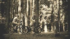 Girls on bicycles in summer garden (koliru) Tags: girls summer sepia canon garden bicycles 6d ef70200mm