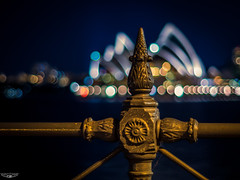 Background Music (Laith Stevens Photography) Tags: longexposure citylights bokeh legacy glass omd em1 olympus om 50mm f14 manual lens opera house fence clear night lights sydney australia nsw vivid cool all flickr ngc