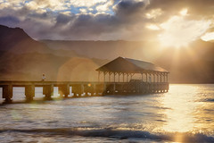 Enjoying the Sunset at Hanalei Bay (ikmalikstudio) Tags: hawaii kauai island tropcial hanaleibay hanalei dock pier ocean pacificocean waves sunset evening dusk reflection sitting person woman lensflare mountains cloudy sunrays