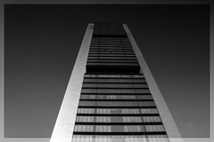 Torre Cepsa (Miguel Angel Prieto Ciudad) Tags: sky city europe tower urban architecture cityscape building black white monochrome spain madrid business