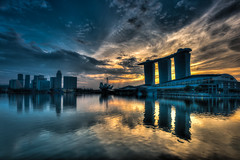 In the beginning (Katherine Young) Tags: city travel blue sky orange sun water architecture clouds marina sunrise reflections landscape bay nikon singapore asia cityscape wideangle esplanade f4 hdr mbs d800 1635mm marinabaysands