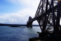 Forth Rail Bridge (Stewcy Productions) Tags: bridge blue red sea sky metal clouds river scotland paint steel sony rail forth a380 alpha sonyphotographing