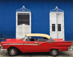 Old red car (piginka) Tags: door old city travel blue red window car wall architecture facade outdoors photography town iron cuba transportation trinidad vacations urbanscene traveldestinations colorimage famousplace buildingexterior builtstructure