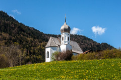 002 -20160429 Oberkirche Weissensee Holiday _MG_0546-2 (jvlady) Tags: flowers trees white lake mountains alps building church yellow architecture forest germany mountainside weissensee
