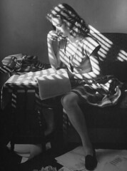 U.S. A young woman reading poetry in her room, La Quinta, California, December 1945 // Photograph by Martha Holmes. (mike catalonian) Tags: portrait bw female photography us fulllength 1940s 1945 marthaholmes