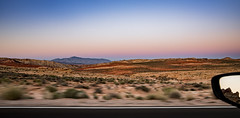 driving by dusk (almostsummersky) Tags: road park travel sunset sky motion blur mountains reflection valleyoffire car mirror us spring sand sandstone driving unitedstates desert dusk horizon nevada cliffs hills motionblur sideviewmirror valleyoffirestatepark redsandstone moapavalley