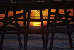 Long-legged.... (Joe Hengel) Tags: ocean california ca sunset sea orange seascape beach clouds golden evening pier seaside waves glow outdoor pacificocean socal pilings southerncalifornia orangecounty oc sanclemente seashore goldenhour eveninglight goldenstate sanclementepier eveningskies cloudsstormssunsetssunrises cloudsorangecounty
