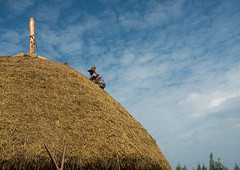 Man covers the thatched roof of a traditional ethiopian house, Kembata, Alaba kuito, Ethiopia (Eric Lafforgue) Tags: africa wood roof sky people house color home horizontal architecture outdoors photography wooden construction village adult african traditional culture straw progress hut typical ethiopia thatched hornofafrica developing ethiopian riftvalley eastafrica thiopien etiopia abyssinia ethiopie etiopa ruralscene unrecognizable onemanonly  etiopija 1people ethiopi alaba  toukoul etiopien etipia halaba  etiyopya  unrecognizableperson    kembata      alabakuito ethio163359